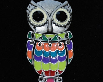 19 inch silver tone chain with clasp and multi colored owl with large eyes pendant made of multiple pieces to give the illusion of movement