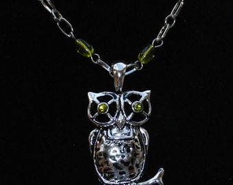 19 inch silver tone and olivine bead chain with clasp and intricate owl with peridot eyes pendant perched on a branch
