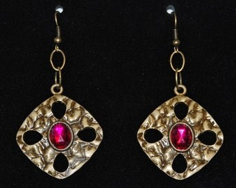 Antique bronze toned intricately detailed metal square earrings with tear drop cut out accents and pink gems