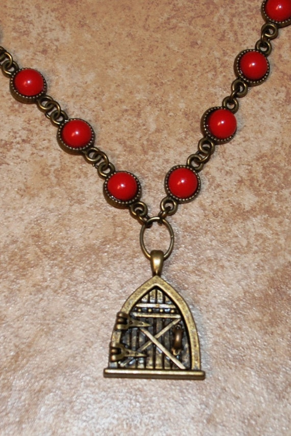 Bronze tone with red stones antique style 24 inch necklace with cottage door locket that opens