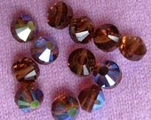 Vintage Swarovski Crystals Smokey Topaz with Aurore Boreal coating  8mm  pack of 12beads
