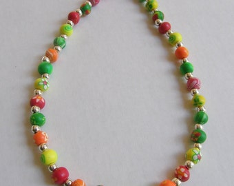 Yellow, orange, green and red polymer clay necklace