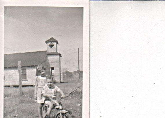 Sister and Brother Playing with a Tricycle Church in Background 1950's Photo Snapshot