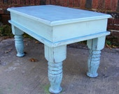 Turquoise Coffee Table with Beautiful Hand Carved Legs and a hinged top for hidden storage