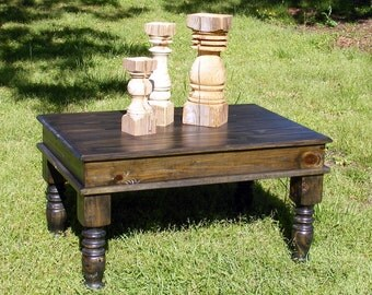 Ebony Coffee Table with Beautiful Hand Carved Legs and a hinged top that opens