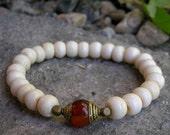 mala men's unisex bracelet, bone prayer beads and Tibetan capped carnelian guru bead