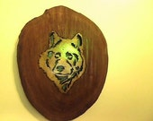 WOLF, INLAID IN A CHERRY LOG