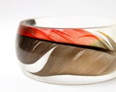resin bangle made with eco resin containing beautiful black Amazon parrot feather