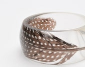 round eco friendly resin bangle - featuring guinea fowl feather