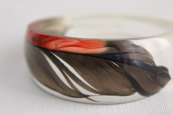 Asymmetrical eco resin bangle with black red green and blue Amazon parrot feather transparent  bangle bracelet
