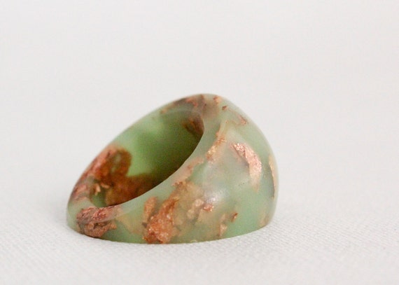 neon green dome ring with suspended copper flakes eco resin