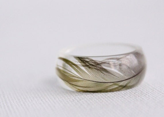 Shiny round eco resin ring with green sun conure parrot feather
