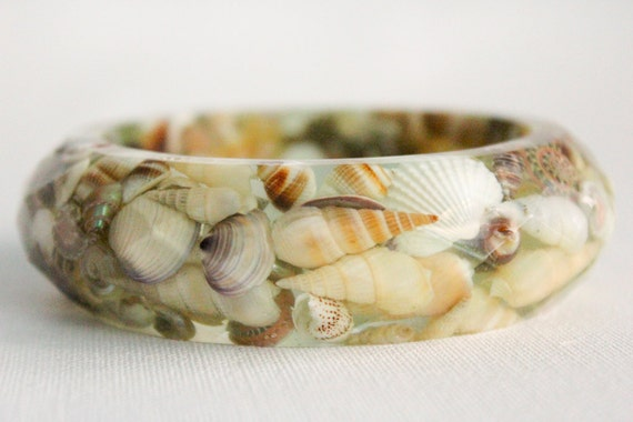 Real shells and starfish suspended in eco resin multifaceted bangle