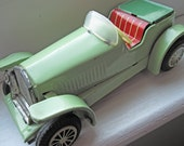 Tin toy car, Japanese, with friction action, sports car, mint green tinplate, litho tin mechanical automobile