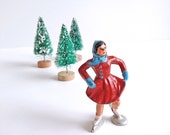 Barclay Winter Village figure, ice skater girl, red dress and blue hat, scarf and gloves, lead figurine