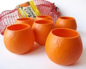 Vintage plastic orange cups, Florida souvenirs, roly poly glasses, fruit shaped drinking cups, Pop-It Corp., mid century kitchen and barware