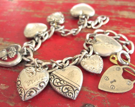 Beverly's charm bracelet with 8 puffy Victorian sterling silver hearts and padlock on a chain, Marine Corps sweetheart jewelry