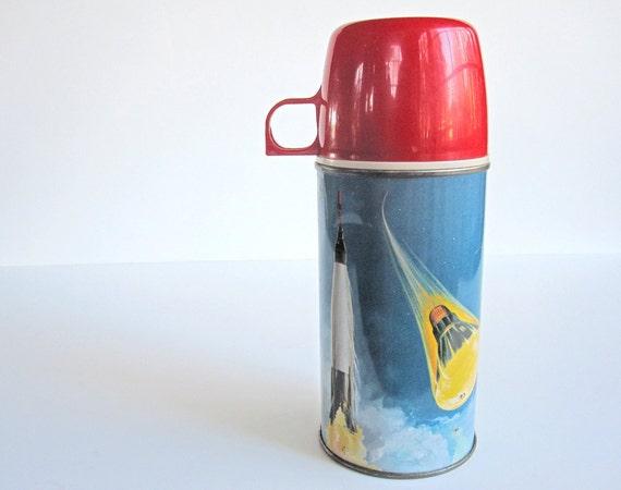 "Vintage thermos, ""Orbit,"" John Glenn, Atlas rocket and Mercury spacecraft, 1963 King-Seely Thermos Co. Bottle No. 2056"