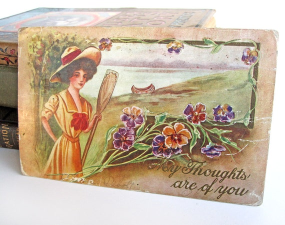 Postcard, with beautiful woman, paddle and canoe, pansies or violas, spring flowers, summer lake, antique Edwardian embossed card