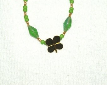Gold Shamrock on a Green Necklace
