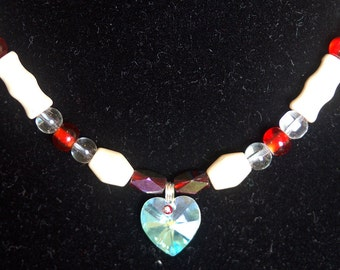 Red and White Necklace with a Heart Pendant