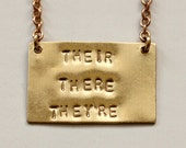 GRAMMAR POLICE' Their, There, They're, hand stamped brass plaque necklace