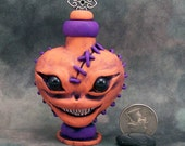Meanie Stitch Head Potion Bottle Orange
