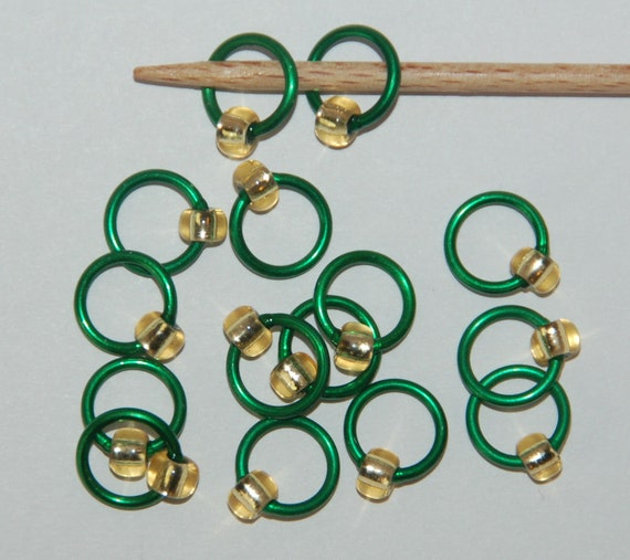 Large silver lined light gold on green stitch markers