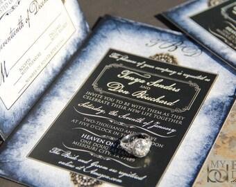 Blue parchment wedding invitations. Vintage pearls wedding invitations. Broch wedding invitations.