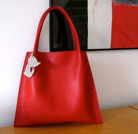 Leather handbag in bright red full grain leather and natural suede lining