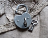 Old french grey metal padlock with keys