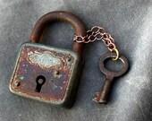 1 french antique Vintage Skeleton Keys ,  old key with locket  black patina