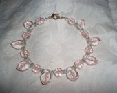 Pale pink glass flowers and leaves bracelet with green crystals