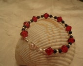 Ruby crackle bicone beaded bracelet with black and silver