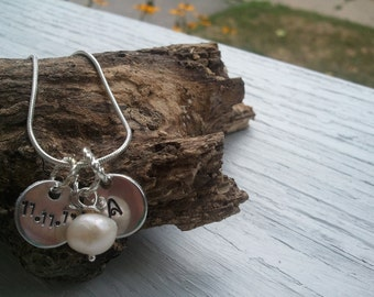 Wedding commemorative necklace.  Newlywed initial and wedding date Hand stamped with freshwater pearl