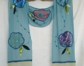Long turquoise scarf with decorative applique flowers
