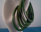 A Set of Five Bakelite Spinach Marbled Bangle Bracelets