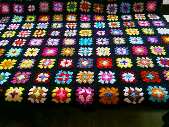 Handmade chunky crochet blanket -  Made in tradition granny type multi colour style with black border   784    (B)