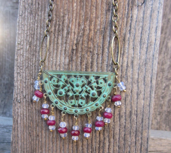 "Verdigris Patinaed Brass ""Join Our Gypsy Caravan"" Half Moon pendant with  AAA Ruby and Moonstone faceted briolettes"