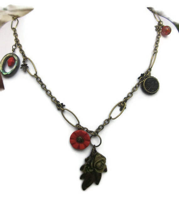 Summer garden at twilight  necklace with flowers, leaves and charms in various colors of orange, black and antiqued brassTAGTMCTT