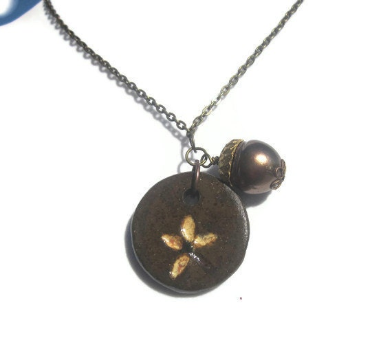 All the leaves are brown Ceramic pendant with swarovski pearl and antiqued brass TAGT