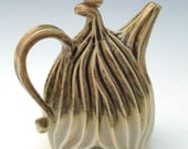 Purple, tan and white carved porcelain teapot