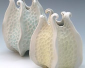 Porcelain urchin vase with curlicues in pale yellow & white