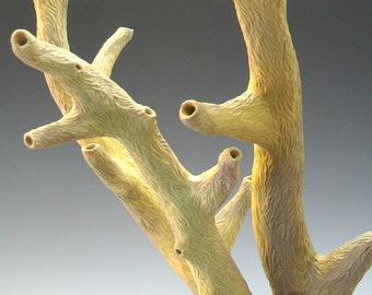 Carved porcelain branch in tan, yellow & grey, faux bois