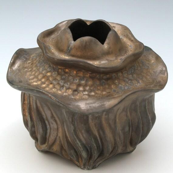Curvy carved porcelain vessel in bronze glaze