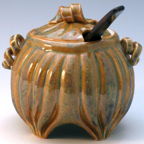 Carved porcelain jam or mustard jar with lid in gold and black