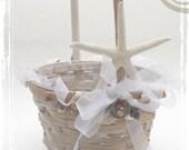 By The Shore. A Flowergirl Basket Decorated With White Starfish Decoration Weddings. Beach Coastal Ocean Sea Wedding Decor