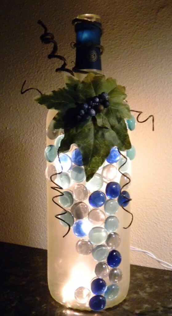 decorative wine bottle light embellished with blue glass gems. Black Bedroom Furniture Sets. Home Design Ideas