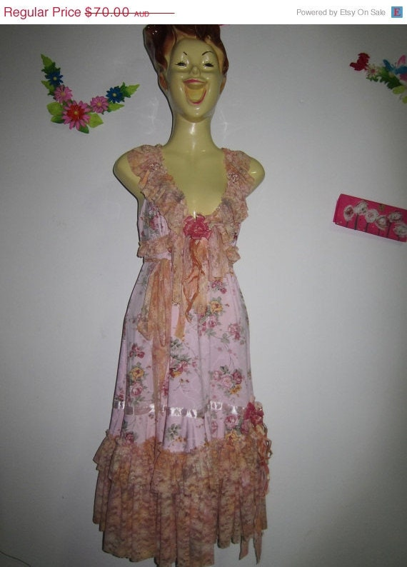 gorgeous vintage inspired dress with double layers of ruffled multihued lace and roses.....