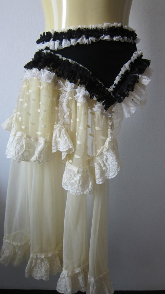 vintage inspired bustle.....black faux suede with ruffles of ivory and black lace and vintage motifs...